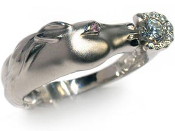 The ring. Platinum or white gold, sapphire, diamonds