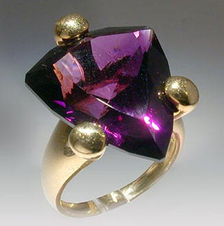 The ring. Gold, amethyste. Jewelry adornments